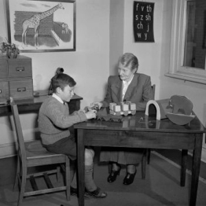 Dr Irene Sabine examining a child at the child guidance clinic, Sydney, 1948. National Archives of Australia, A1200, L11115.